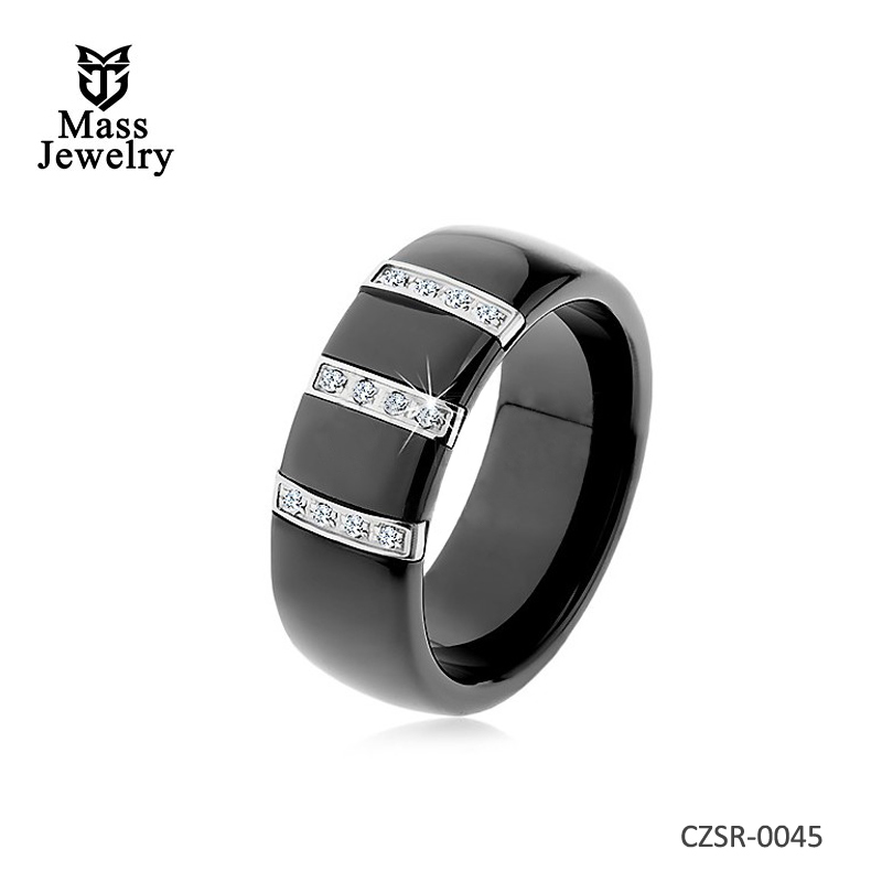 Black ceramic ring with smooth surface, three steel strips with zircons