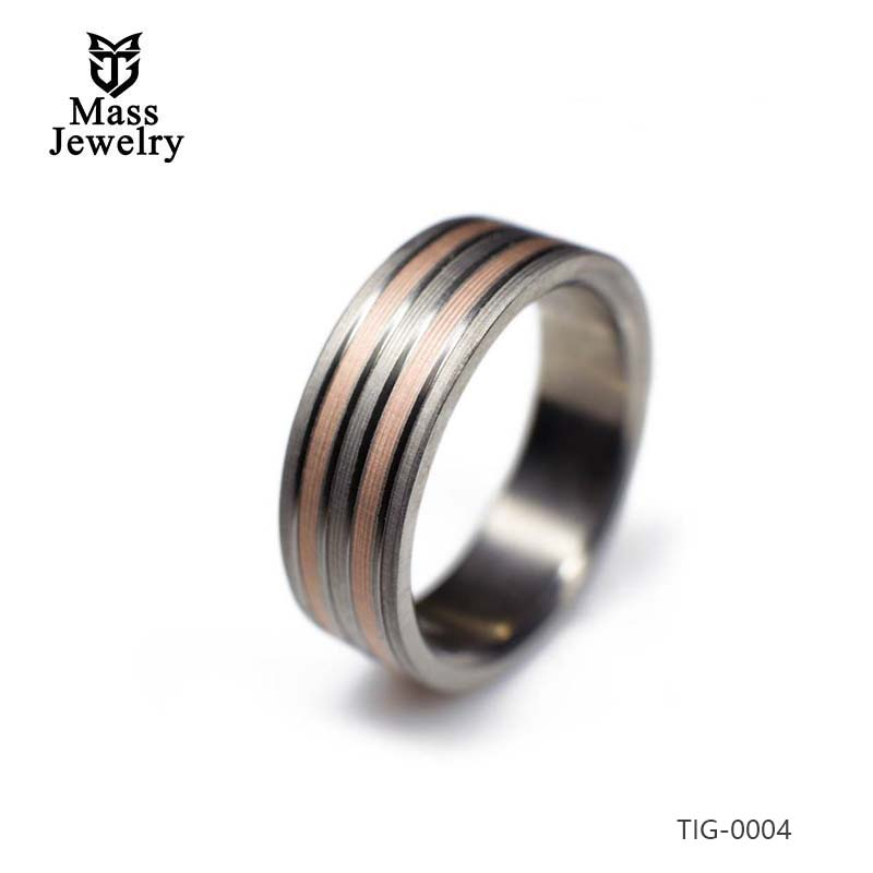 Titanium Ring With Highlighted 14k Rose Gold Inlays